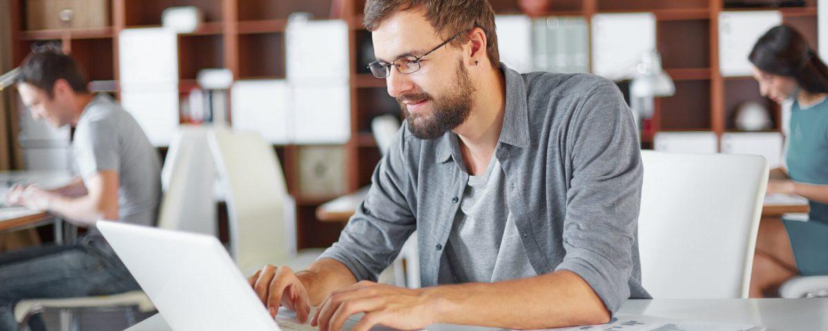 a white man using his laptop